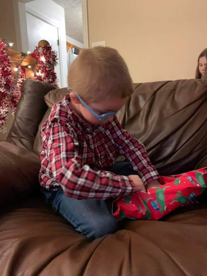Liam opening Christmas gifts.